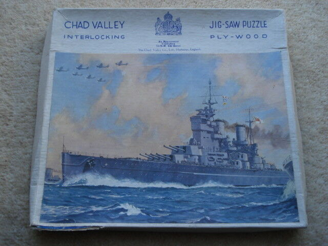 C1930S VINTAGE CHAD VALLEY BATTLESHIP IN FLOTILLA WITH 7 AIRCRAFT FLYING ABOVE