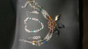 Tapered-box-weave-set-with-Celtic-flower-pendant