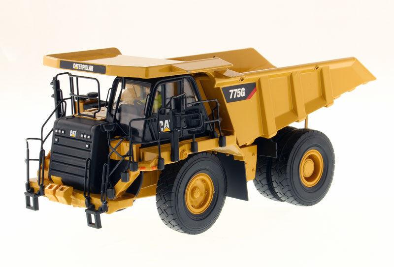 DCM85909 - CATERPILLAR 755G accompagné d'une figurine et d'une boite en métal -