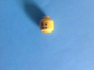 LEGO-MINIFIGURE-HEAD-YELLOW-HEAD-WITH-SMILEY-FACE-amp-BROWN-EYEBROWS-DECORATION