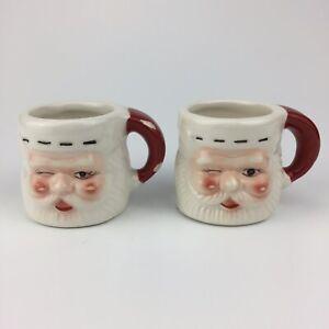 Pair Of Small Mini Ceramic Winking Santa Claus Mug