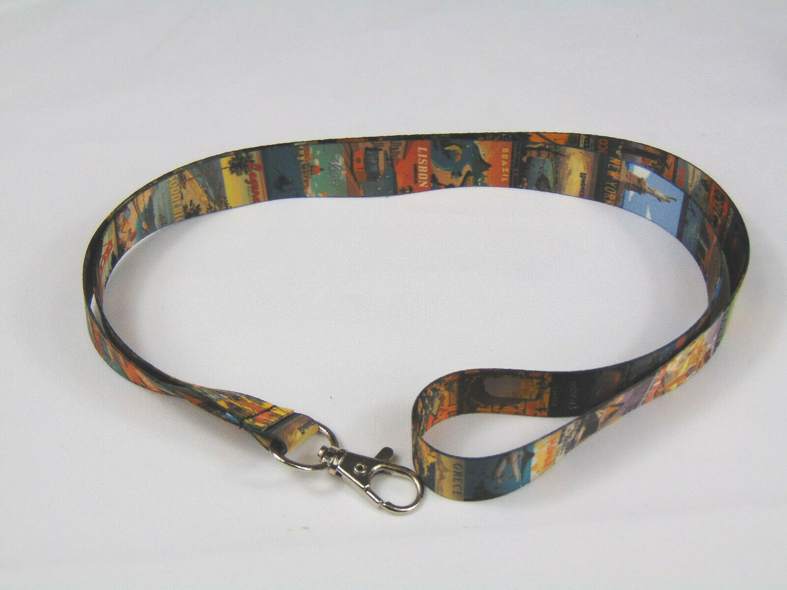 A vintage travel printed neck strap lanyard for ID, keys etc. Made in the UK.