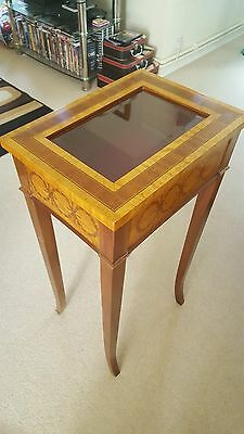Beautiful Occasional Table with Glass Lid