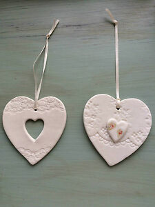 Vintage-Inspired-Handcrafted-Ceramic-Ivory-Hanging-Hearts-by-Amanda-Mercer