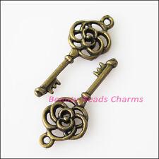 50Pcs Antiqued Bronze Tone Flower Keys Charms Pendants 10.5x27mm
