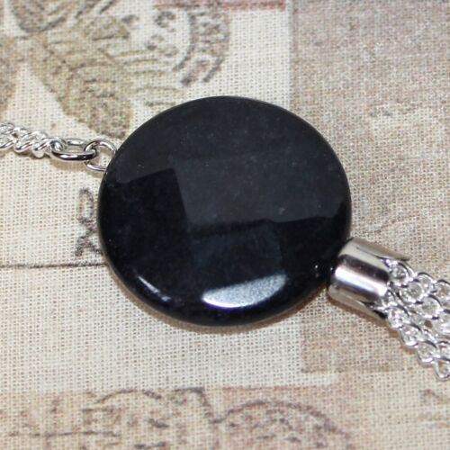 Long silver necklace with charcoal black agate focal bead and tassel pendant