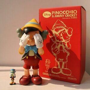 Original-Fake-Kaws-Pinocchio-and-Jiminy-Cricket-Pinocho-28cm-figure-with-box