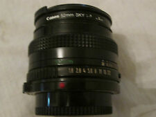 CANON CAMERA LENS FD 50MM 1:18 WITH CANON 52MM SKY 1A FILTER