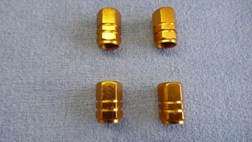 SAAB GOLD METAL POLVERE TAPPI VALVOLA PNEUMATICO RUOTA in alluminio solido ESAGONO COVER 4pz