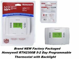 Honeywell RTH2300B1012  5-2 Day Programmable Backlight Thermostat  NEW