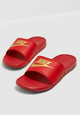 red and gold nike slides