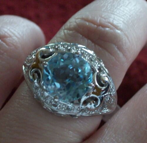 Sky Blue Topaz 4.77CTW Round with White Topaz .50CTW Round Sterling Silver Ring