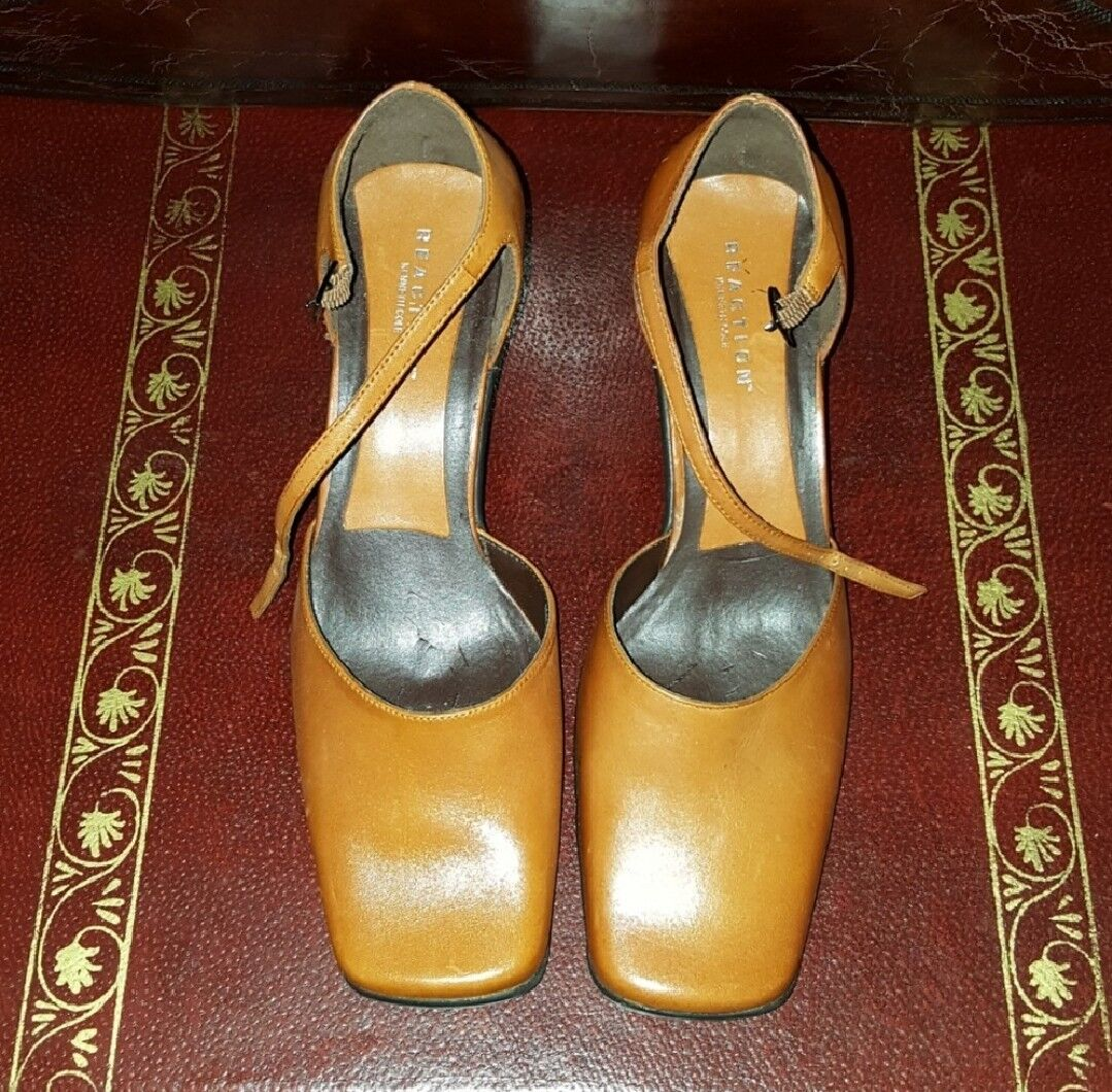 Kenneth Cole Reaction rust ankle-strap shoes with 2.5-inch heels.  Size 7.5 M.
