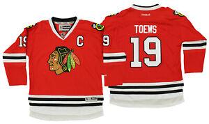 6e4acb9b4f3 Image is loading Reebok-NHL-Youth-Chicago-Blackhawks-Jonathan-Toews-19-