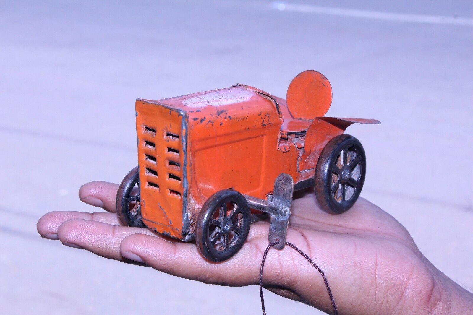 Vintage naranja Wind Up Litografía Apisonadora Juguete de estaño