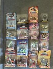 LOT OF 16 SKYLANDER SUPER CHARGERS 8- CHARACTERS, 7- VEHICLES, 1- KAOS TROPHY