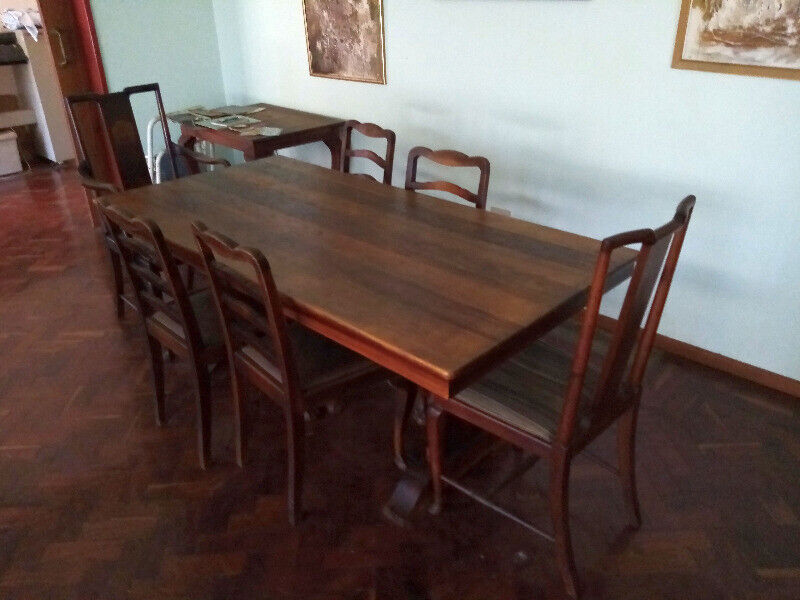 Antique blackwood dining room table and chairs
