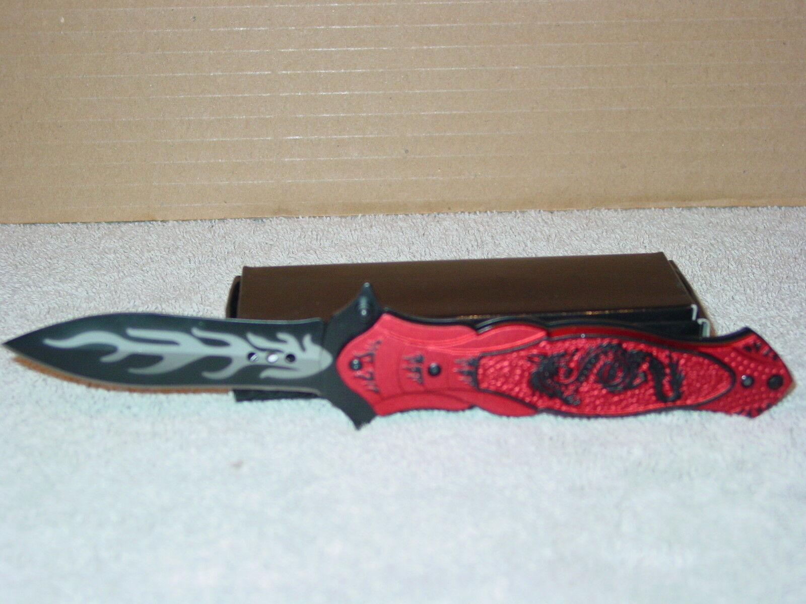 BLACK DRAGON RED HANDLE SPRING ASSISTED KNIFE WITH BELT CLIP