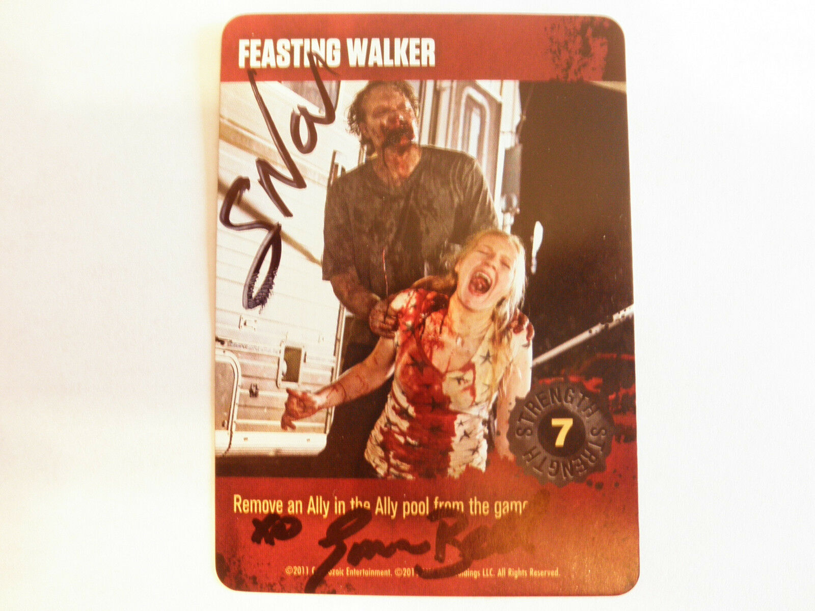 Autographed Walking Dead card - Feasting Walker (Greg Nicotero and Emma Bell)