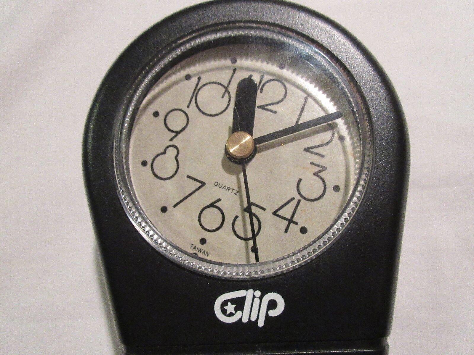 """Clip"", Clock and Big Paperclip Combination"