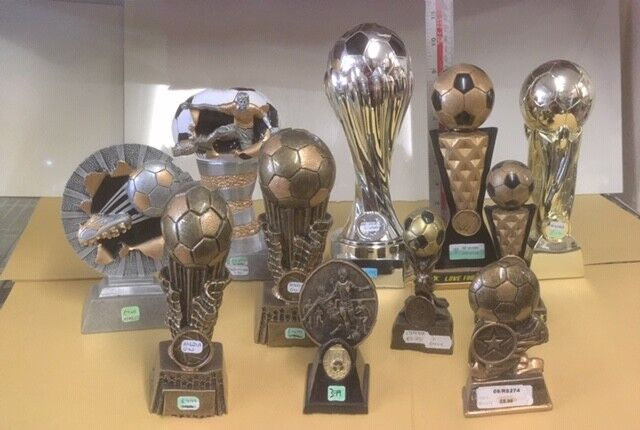 11 x New Football Trophies - Mixed Boot & Ball, Ball & Figure RRP .37