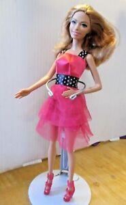BARBIE-DOLL-model-pose-HONEY-BLONDE-HAIR-BRIGHT-PINK-DRESS-AND-HIGH-HEELS