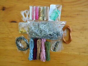 Grab bag lot of assorted beading wires and cords.