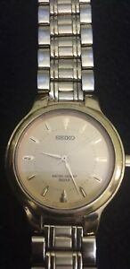 Seiko-quartz-mens-watch-gold-Water-Resistant-50M-Gold-Dail-And-Gold-Bezel-Band
