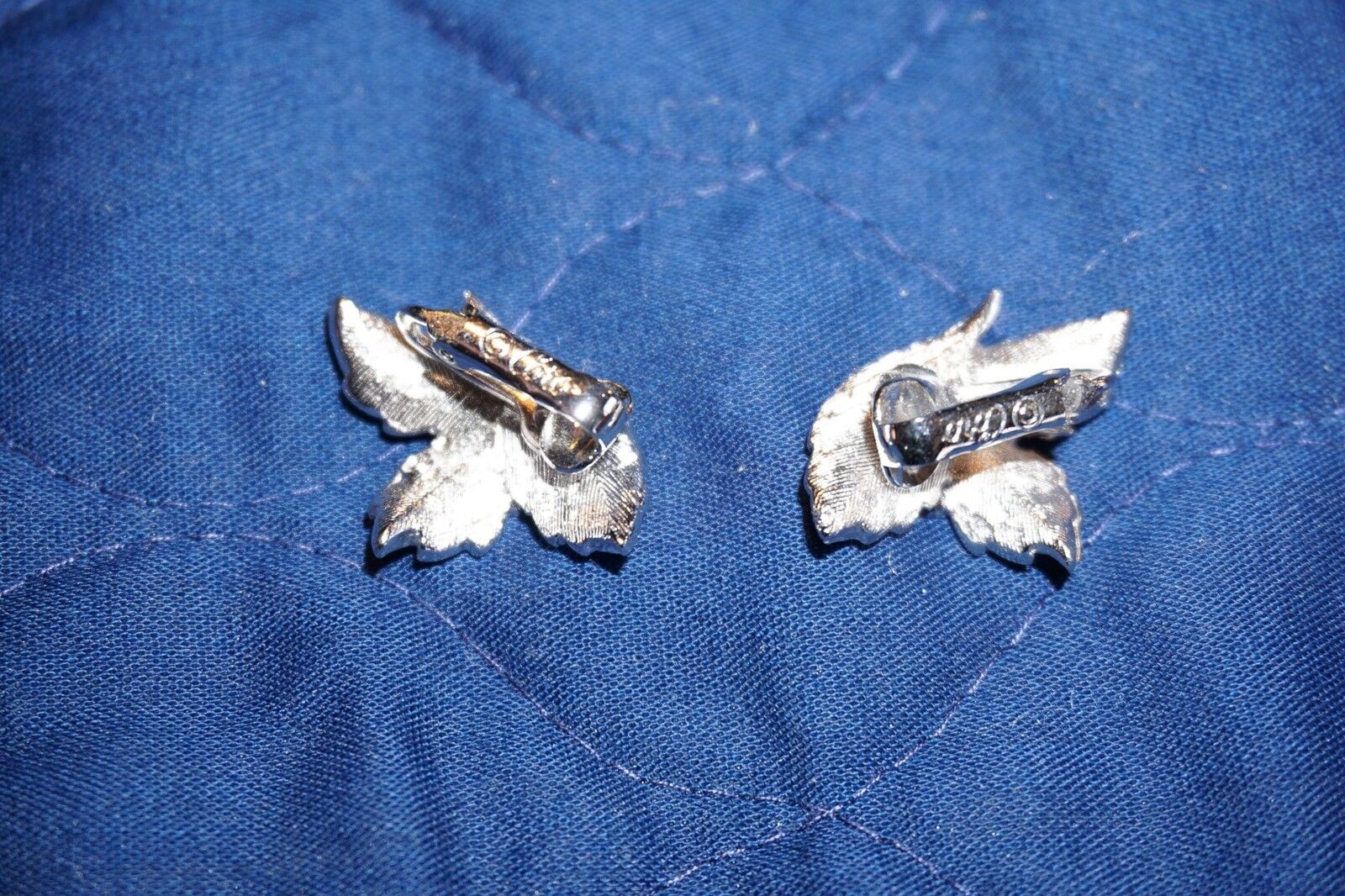 Leaf shaped silver tone vintage clip on earrings with blue stones and frosted enamel signed Rochelle Australian vintage