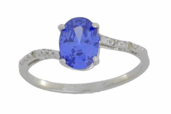 14Kt White gold Tanzanite & Diamond Oval Ring