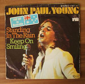 Single-7-034-VINYL-John-Paul-Young-Standing-in-the-rain-Ariola-17677at