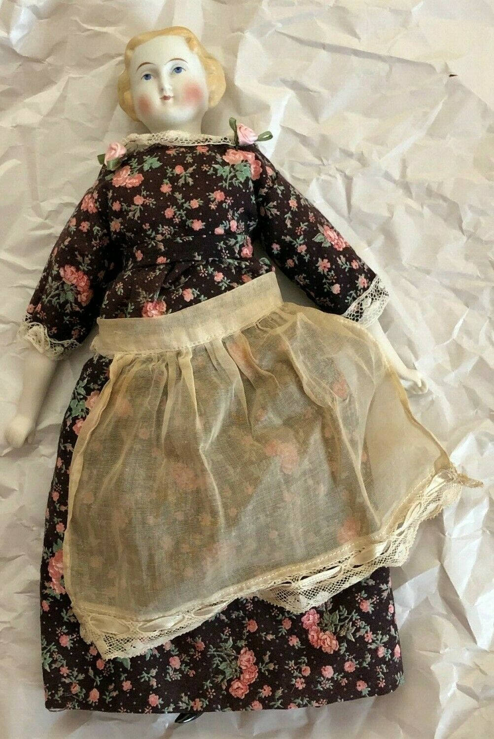 VINTAGE PORCELAIN HEAD LOWER LEGS AND LOWER ARMS AND CLOTH DOLL WITH APRON