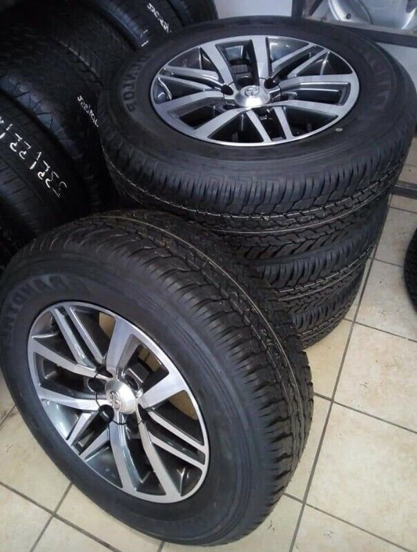 """18"""" Toyota Hilux/Fortuner mags with brand new 265/60/18 Dunlop Grandtrek AT set for R13799."""