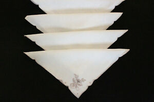 Four-beige-table-napkins-with-taupe-embroidered-corner-Weddings-high-teas-etc