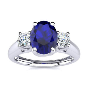 14K-GOLD-1-1-5-CARAT-OVAL-SHAPE-SAPPHIRE-AND-TWO-DIAMOND-RING-In-3-Gold-Colors