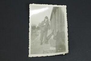 WW2-Era-Photo-World-War-2-Man-in-wig-sweeping-at-barracks-original-photograph