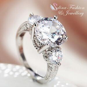 18K-White-Gold-Plated-Simulated-Diamond-Round-Cut-Three-Stones-Engagement-Ring