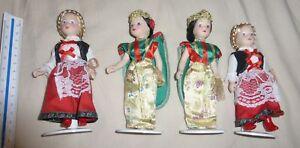 4-petites-poupees-porcelaine-sur-socle-14-cm