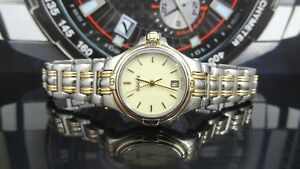 d72ef3c956f Gucci 9040L Silver   Gold Tone White Dial Date Indicator Women s ...