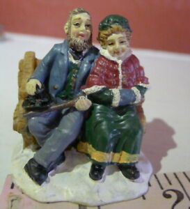 Grandeur-Noel-Victorian-Village-Older-Couple-On-a-Bench-Christmas-1999-Replace