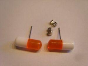 Ohrring-Form-einer-Kapsel-Tablette-weiss-orang-ca-1-5-cm-Lang-aus-Kunststoff-4207