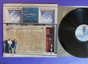 CATE-BROS-IN-ONE-EYE-AND-OUT-THE-OTHER-asylum-76-USA-Lp-mint