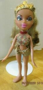 Bratz-doll-long-blonde-hair-pink-lips-jean-shorts-black-skirt-summer-top