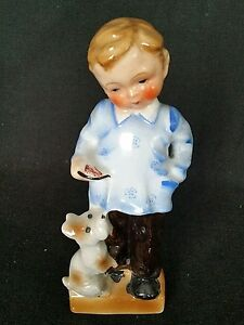 Little Boy Feeding His Dog Hand Painted 8 inches Tall Made in Japan