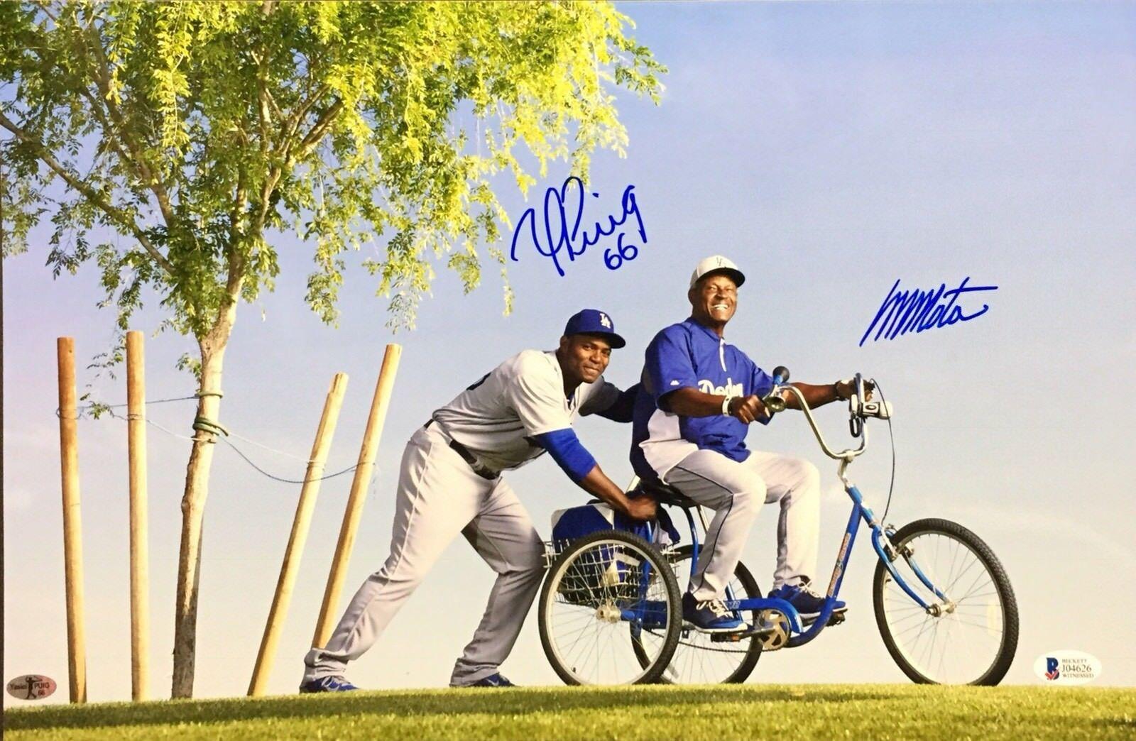 Yasiel Puig & Manny Mota Signed 11x17 Photo on Bike *Dodgers Beckett J04626