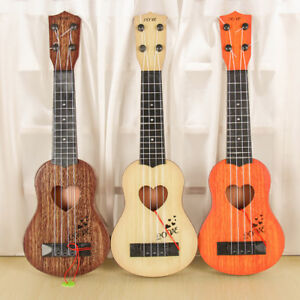 HD-KQ-Classic-Mini-Four-Strings-Ukulele-Guitar-Musical-Instrument-Kids-Toy-Flo