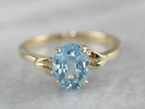 Blue Topaz Gold Solitaire Ring - image 1
