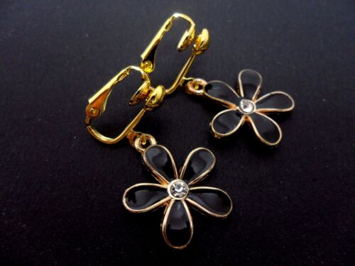 A PAIR OF  CUTE GOLD AND BLACK COLOUR FLOWER CLIP ON EARRINGS NEW.