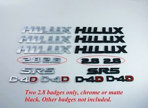 Two-2-8-Badges-for-2015-2016-2017-2018-Hilux-Black-or-Chrome