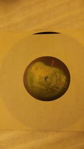 THE-BEATLES-45-RECORD-REAL-LOVE-WITH-PICTURE-SLEEVE